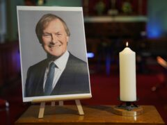 A candle and a photo at a vigil at St Michael & All Angels church in Leigh-on-Sea Essex (Kirsty O'Connor/PA)