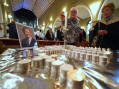 People light candles during a vigil at St Michael's & All Angels church in Leigh-on-Sea in Essex for Conservative MP Sir David Amess (Kirsty O'Connor/PA)