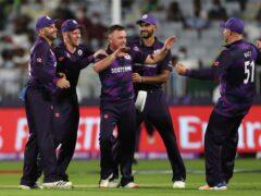 Scotland's bowler Chris Greaves, middle, celebrates after taking a wicket against Bangladesh (Kamran Jebreili/AP)