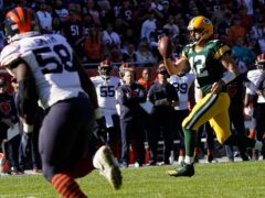 Aaron Rodgers ran in a touchdown as the Green Bay Packers beat the Chicago Bears (David Banks/AP)