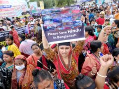 Hundreds of Hindus protesting against attacks on temples and the killing of two Hindu devotees in another district shout slogans in Dhaka, Bangladesh (Mahmud Hossain Opu/AP)