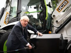 Prime Minister Boris Johnson unveiled a hydrogen-powered JCB telescopic handler, as the construction equipment firm announced it is investing £100m in a project to produce super-efficient hydrogen engines (Stefan Rousseau/PA)