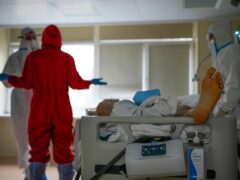 Medical staff wearing protective gear look after a coronavirus patient in a Moscow hospital (AP Photo/Alexander Zemlianichenko)