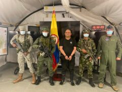 """One of Colombia's most wanted drug traffickers, Dairo Antonio Usuga, alias """"Otoniel,"""" leader of the violent Clan del Golfo cartel, is presented to the media while flanked by armed soldiers at a military base in Necocli (Colombian presidential press office/AP)"""