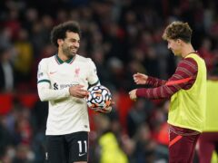 Mohamed Salah (left) scored a hat-trick in Liverpool's 5-0 win at Manchester United (Martin Rickett/PA)