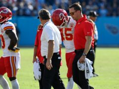 Kansas City Chiefs quarterback Patrick Mahomes (15) is helped off the field after being hit during his side's loss to the Tennessee Titans (Mark Zaleski/AP)