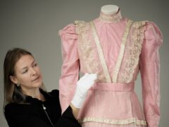 The pink satin dress with lace overlay worn by Princess Elizabeth to play Lady Christina Sherwood in Old Mother Red Riding Boots in 1944 (Royal Collection/PA)