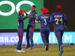 Mujeeb Ur Rahman (second left) took centre stage with three top-order wickets in an over (Aijaz Rahi/AP)