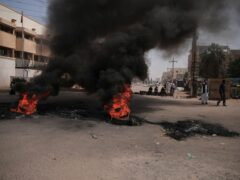 People burn tyres during a protest a day after the military seized power in Khartoum, Sudan (Marwan Ali/AP)