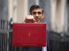 Chancellor of the Exchequer Rishi Sunak holds his ministerial 'Red Box' as he stands with his ministerial team and Parliamentary Private Secretaries, outside 11 Downing Street (PA)