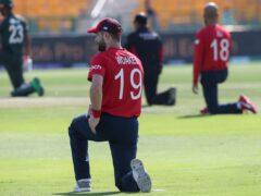 England's Chris Woakes takes the knee ahead of the T20 World Cup game with Bangladesh (Aijaz Rahi/AP)