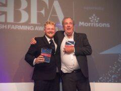 Kaleb Cooper and Jeremy Clarkson with their award (Amazon Prime Video Clarkson's Farm/PA)