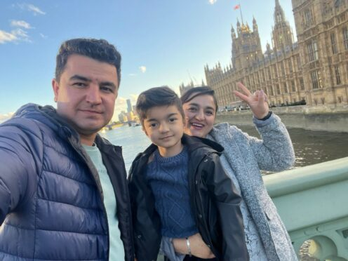 Burhan Vesal with his wife and son (Burhan Vesal/PA)