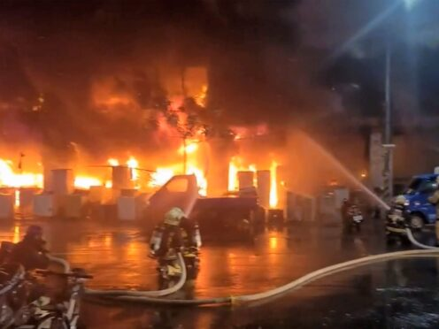 In this image taken from video by Taiwan's EBC, firefighters battle a blaze at a building in Kaohsiung, in southern Taiwan on Thursday, Oct. 14, 2021. The fire engulfed a 13-story building overnight in southern Taiwan, the island's semi-official Central News Agency reported Thursday. (EBC via AP )
