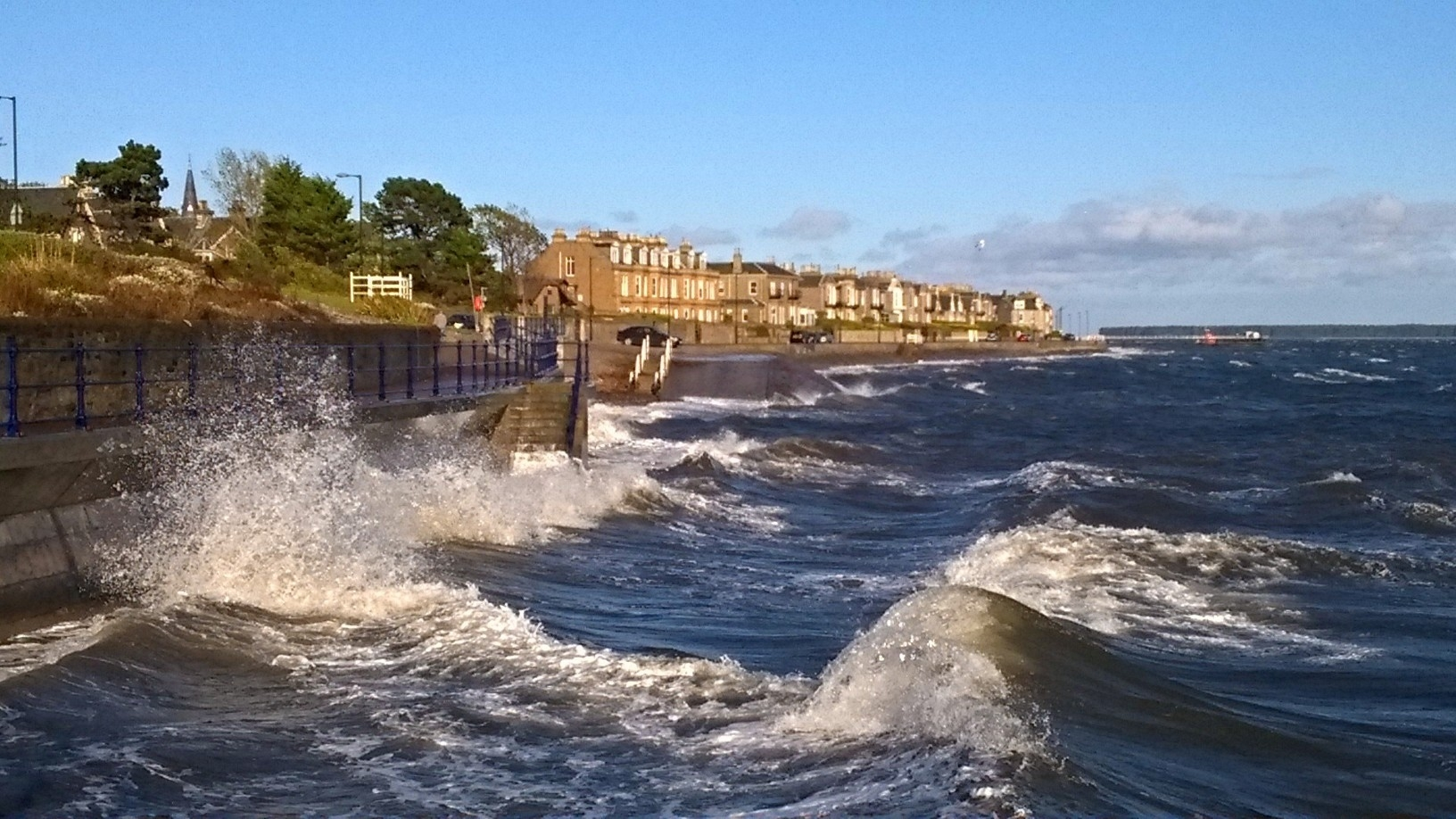 Under a pretty blue sky, the waves of the Tay at Broughty Ferry tell the truth of a windy day in this shot by Jim Glover.