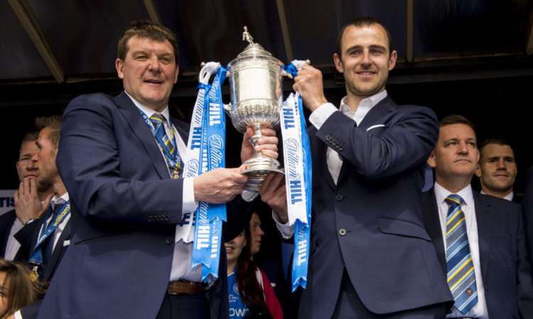 Departing St Johnstone manager Tommy Wright and Dave Mackay show off the Scottish Cup to the Perth public.
