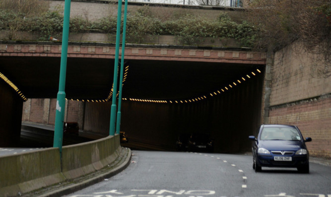 The car sped long the wrong side of Marketgait, through the tunnel