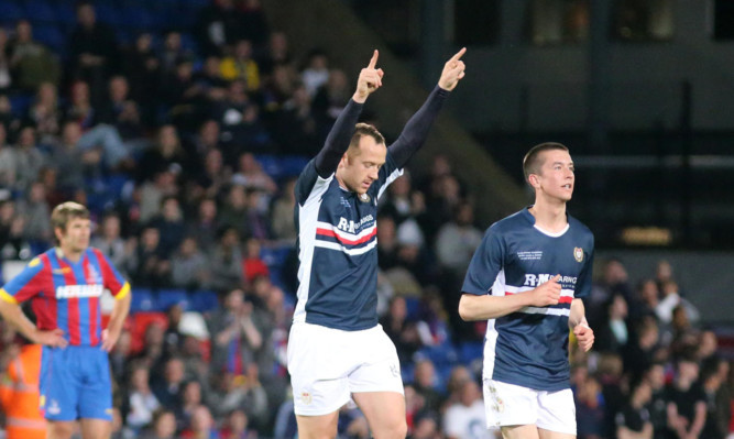 Charlie Adam points to the heavens after scoring for Dundee in Julian Speroni's testimonial.