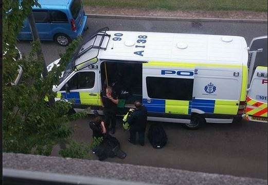 Police outside a house in Dundee.