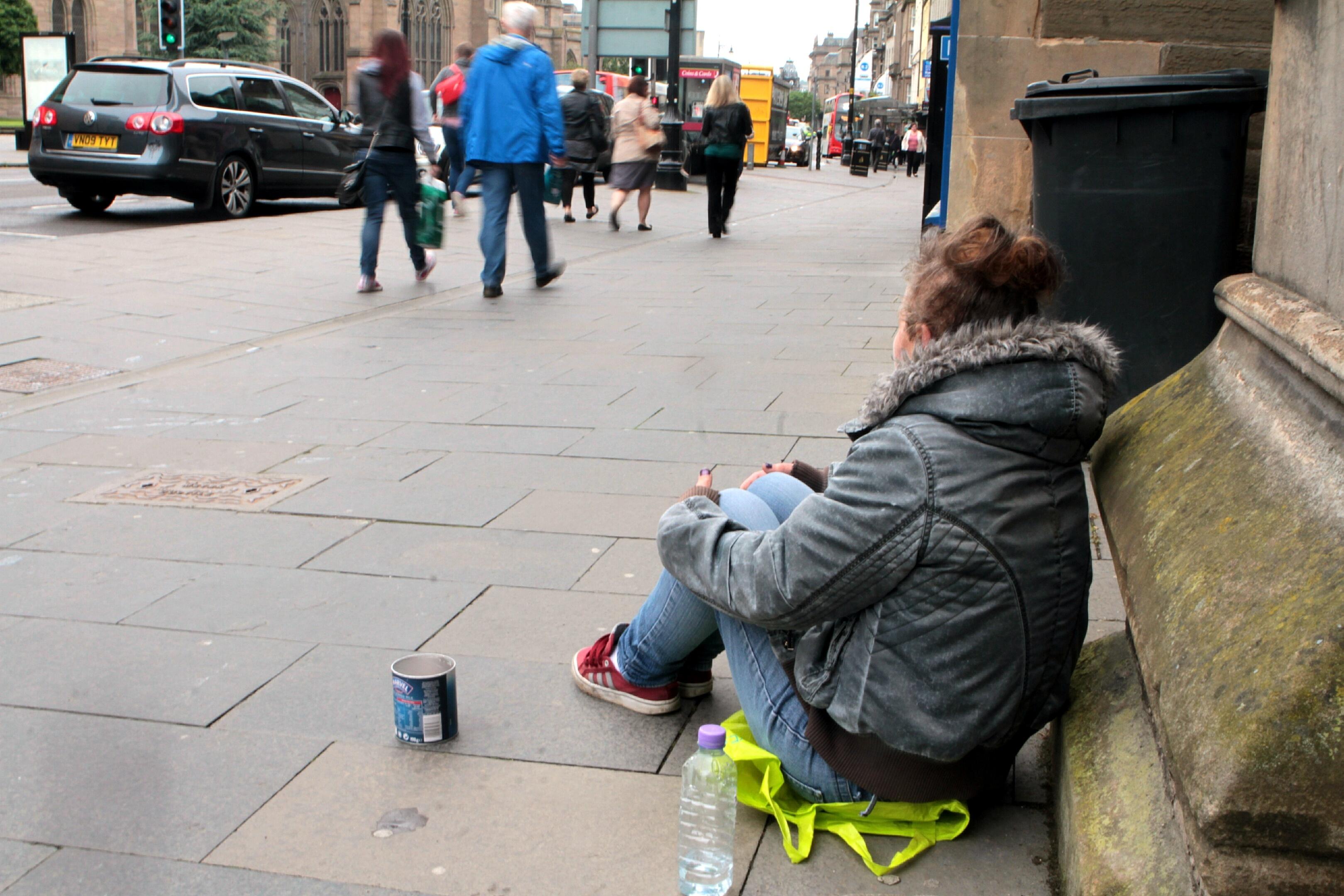 A beggar outside Meadowside St Pauls Church.