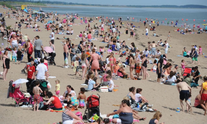 Sun seekers enjoy a balmy day in Broughty Ferry beach