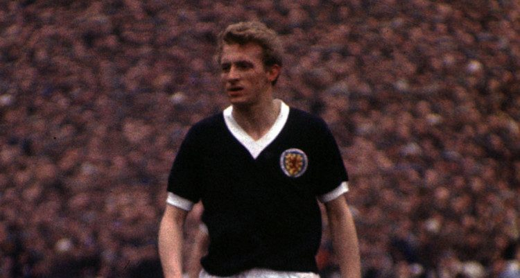 Denis Law pictured in action for Scotland.