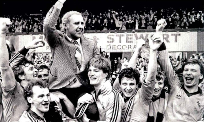 Jim McLean's finest moment as he is lifted shoulder-high by his Dundee United players after clinching the Scottish Premier League title at Dens Park in 1983.