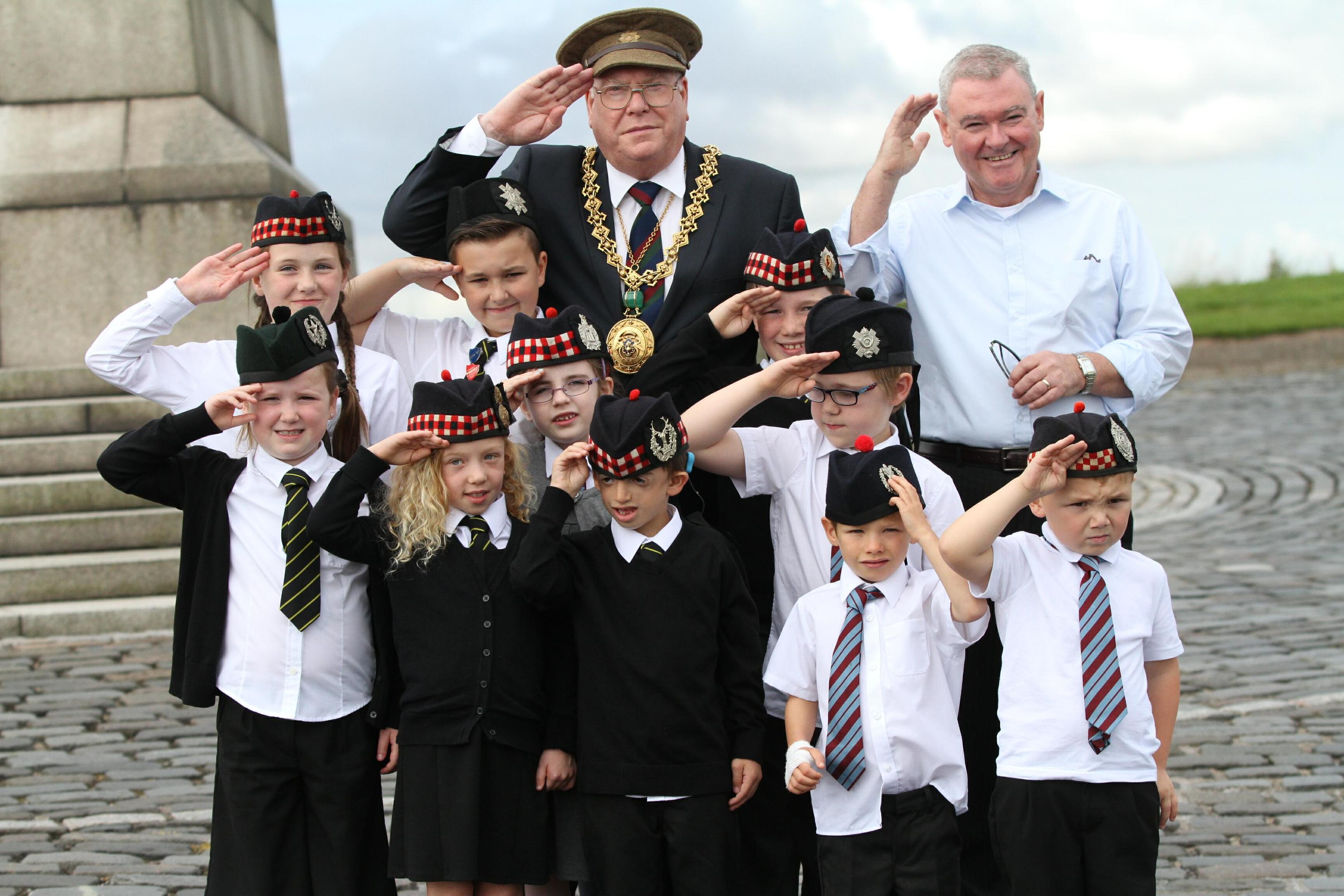 Kids from Dens Road and SS Peter and Paul primary schools with Lord Provost Bob Duncan (back centre) and Dr Billy Kenefick (back right) at the city's war memorial.