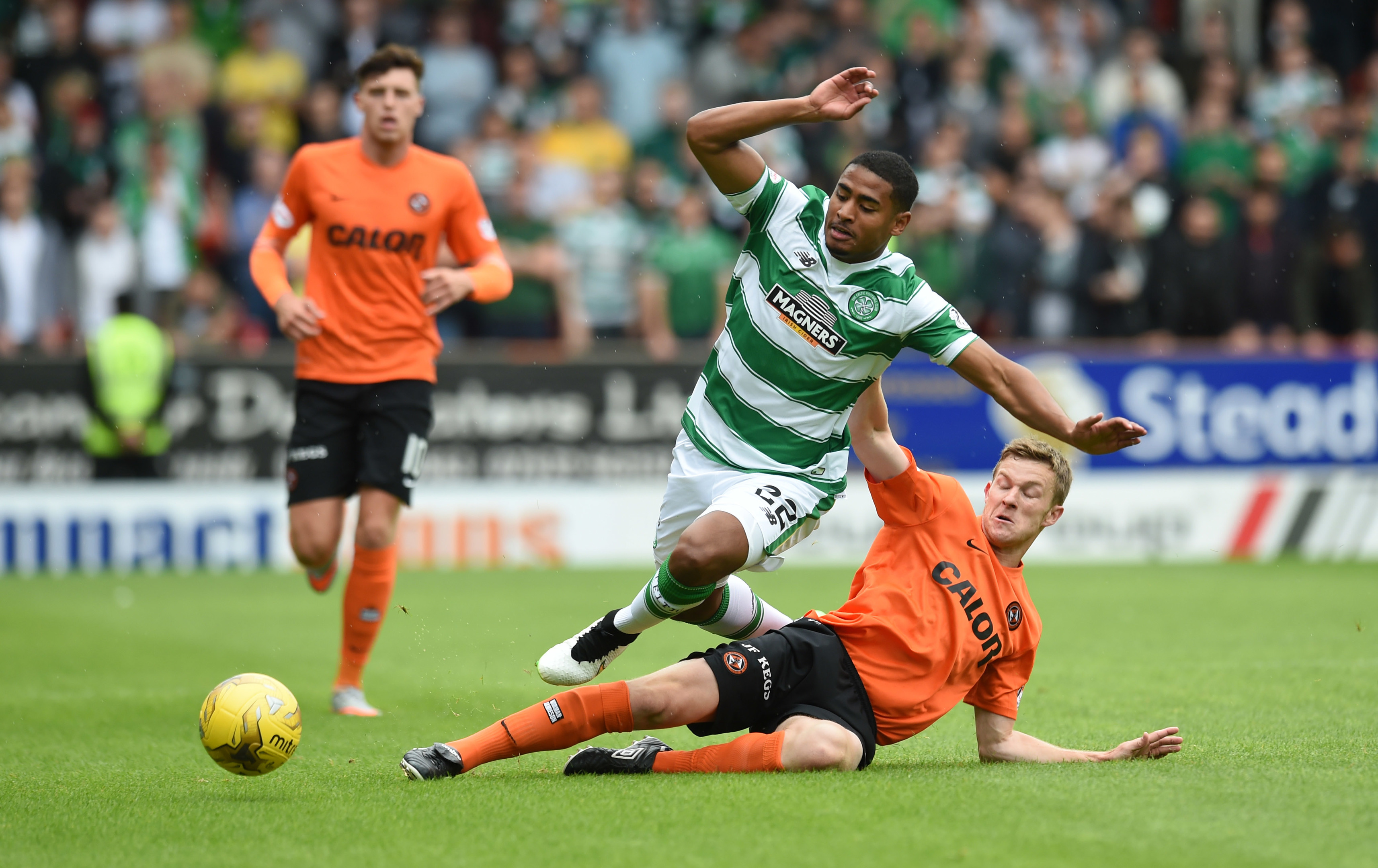 Dundee United full-back Paul Dixon tackles Celtic's Saidy Janko