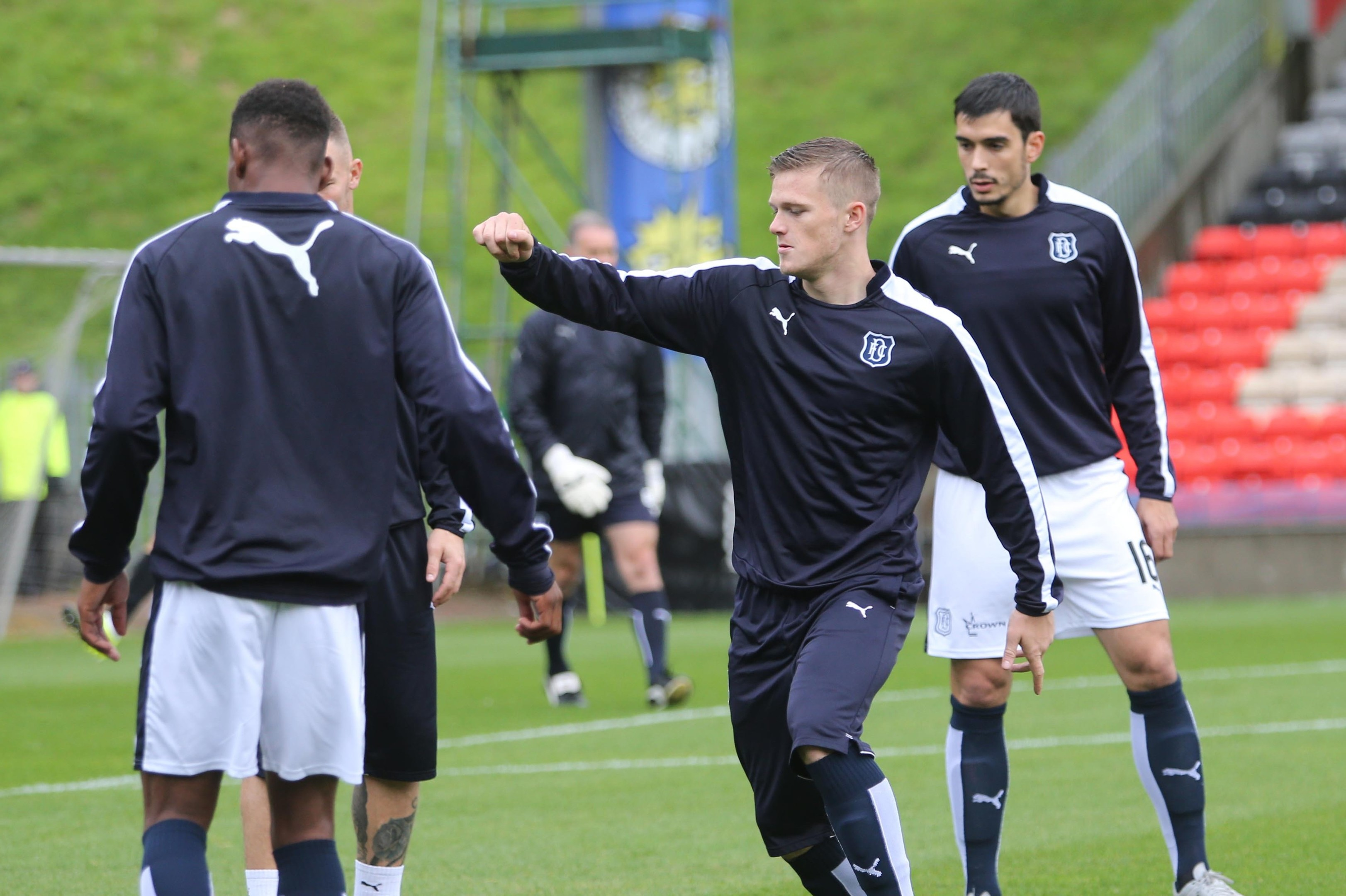 Dundee striker Rhys Healey — seen here warming up with his team-mates at Firhill on Saturday — hopes his time on the bench will be temporary. (Picture by David Young)