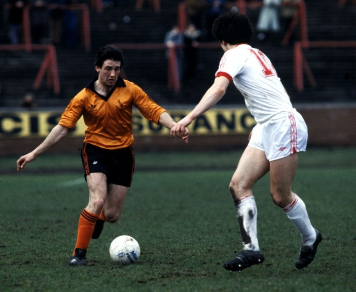 Ralph in action for Dundee United against Partick Thistle in 1981