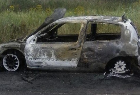 The burnt out car.
