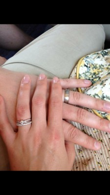 The engagement and wedding rings.