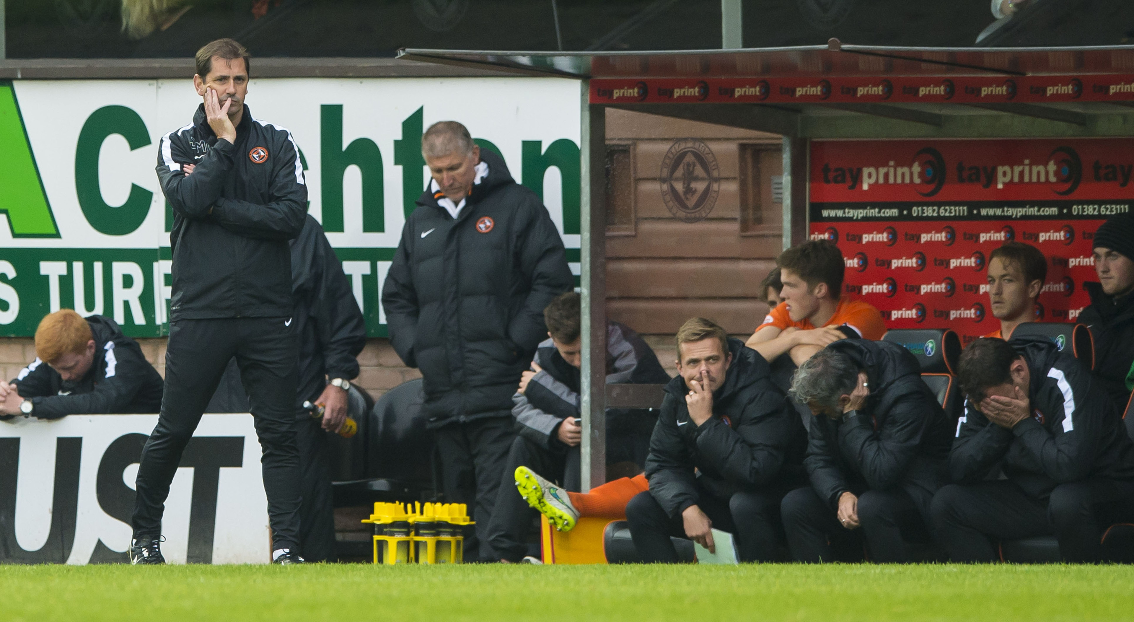 Dundee United boss Jackie McNamara (left) and his coaching staff suffered in the dugout as Killie took all three points at Tannadice.