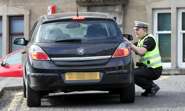 Police will be chatting to, and warning drivers, as they launch their road safety campaign outside schools in Dundee on Monday. (Library image courtesy of Gareth Jennings/DCT Media).