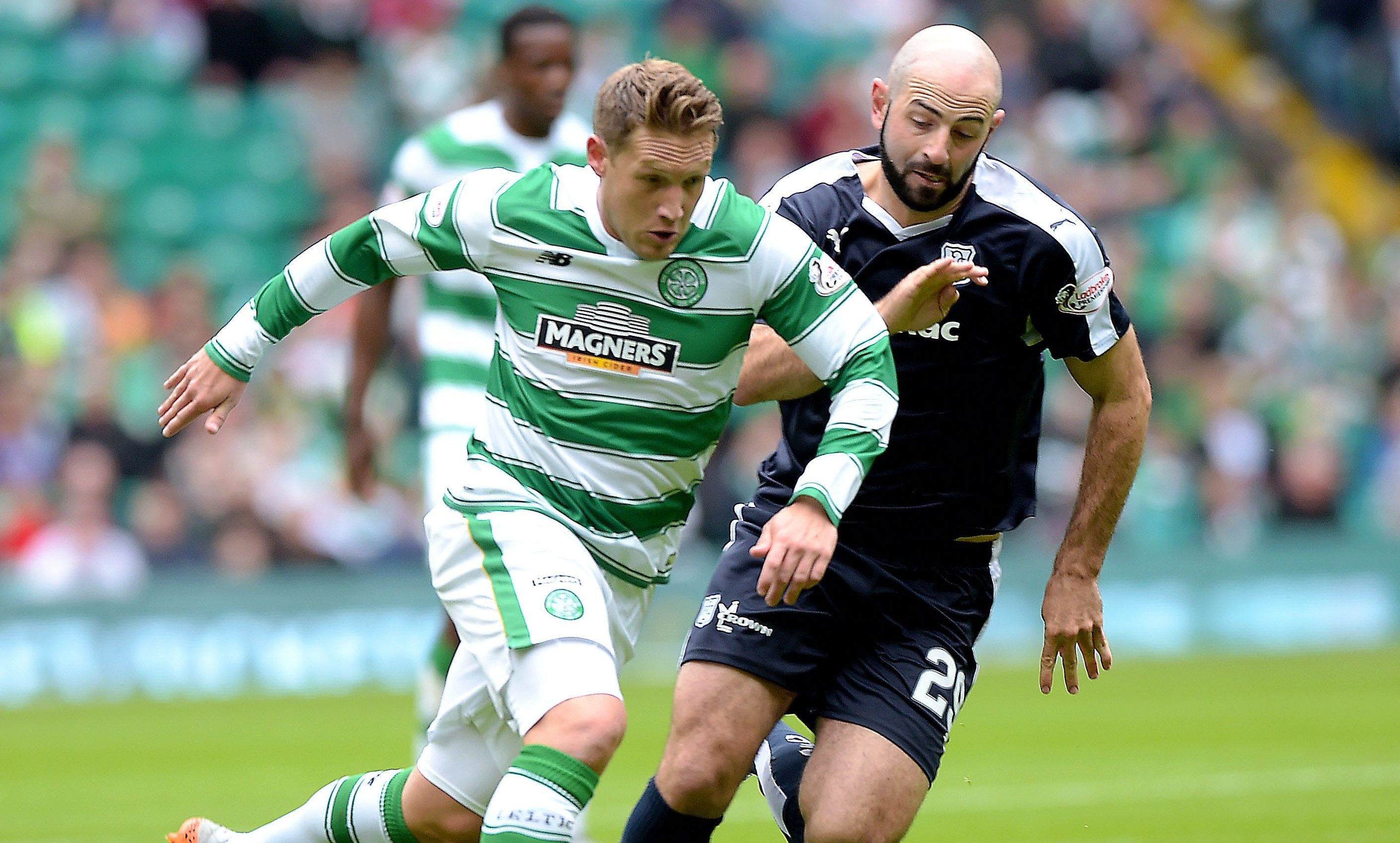 Kris Commons in action against Dundee last season.