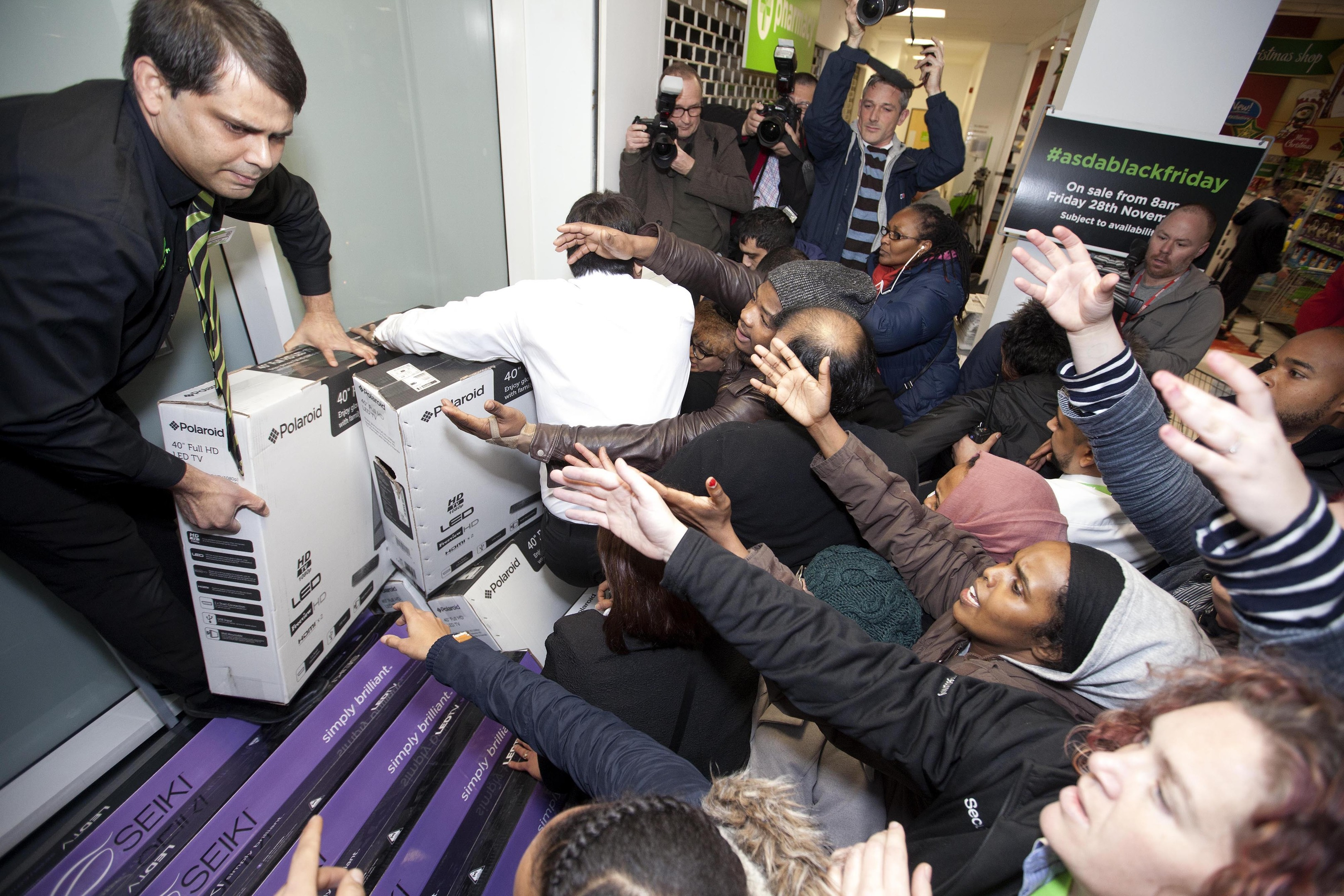 Shoppers scramble to grab a bargain at a previous Black Friday event