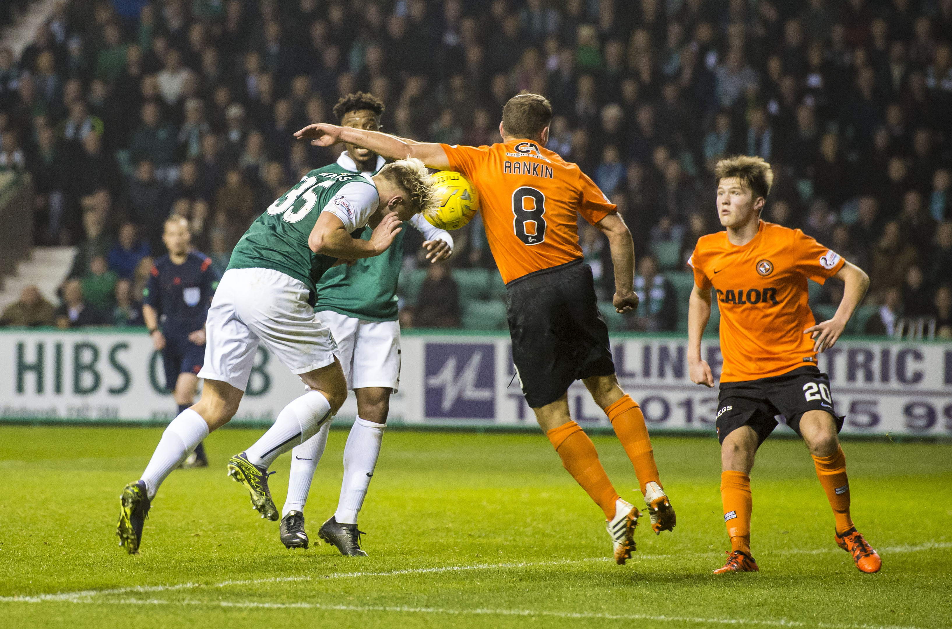 Referee Willie Collum took a firm view that Dundee United's John Rankin's arm struck the ball in the box and awarded a penalty to Hibs during the League Cup quarter-final clash at Easter Road.