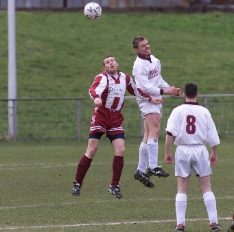 Lee Bertie jumps for a header during a 2002 match