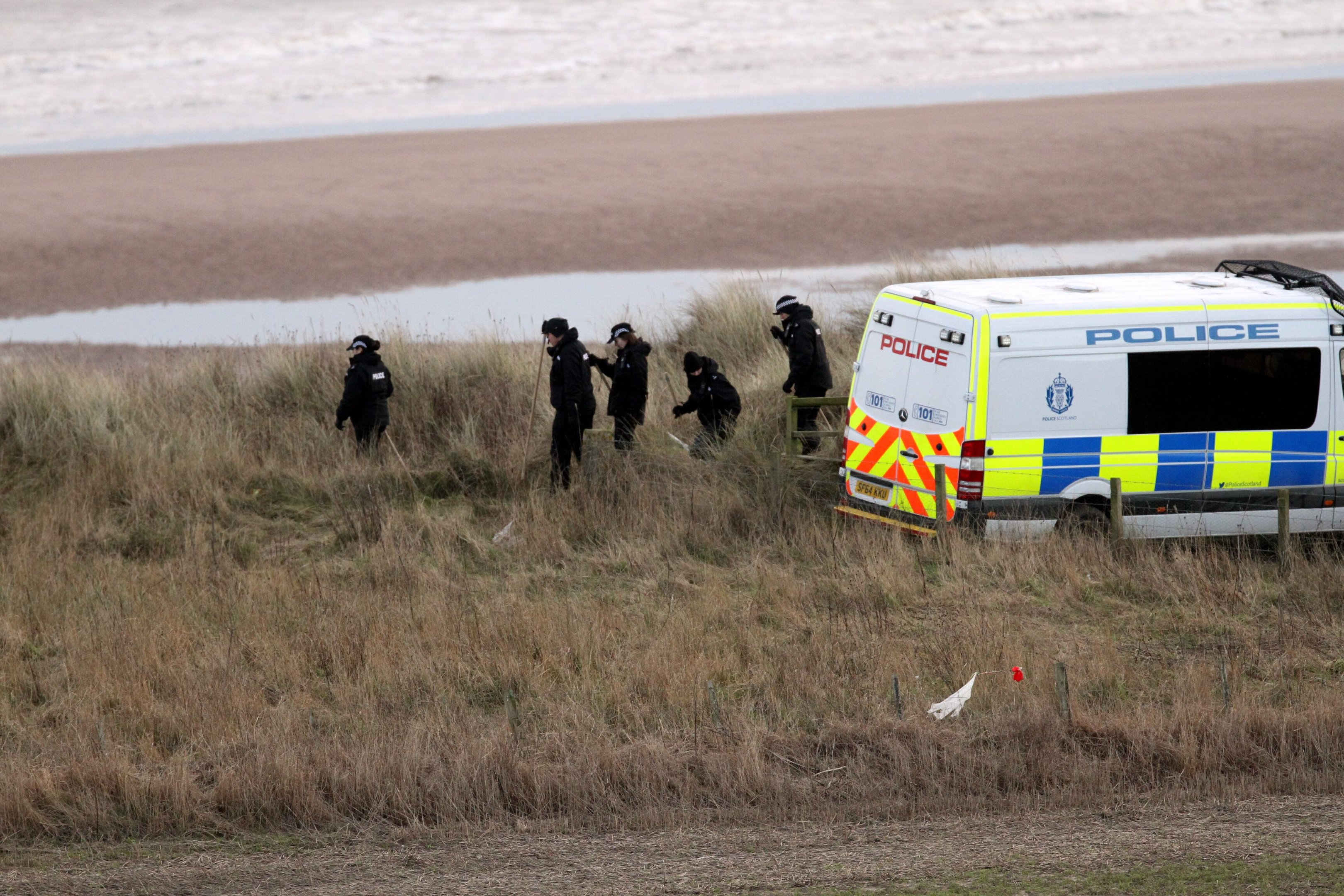 Police officers at the beach.