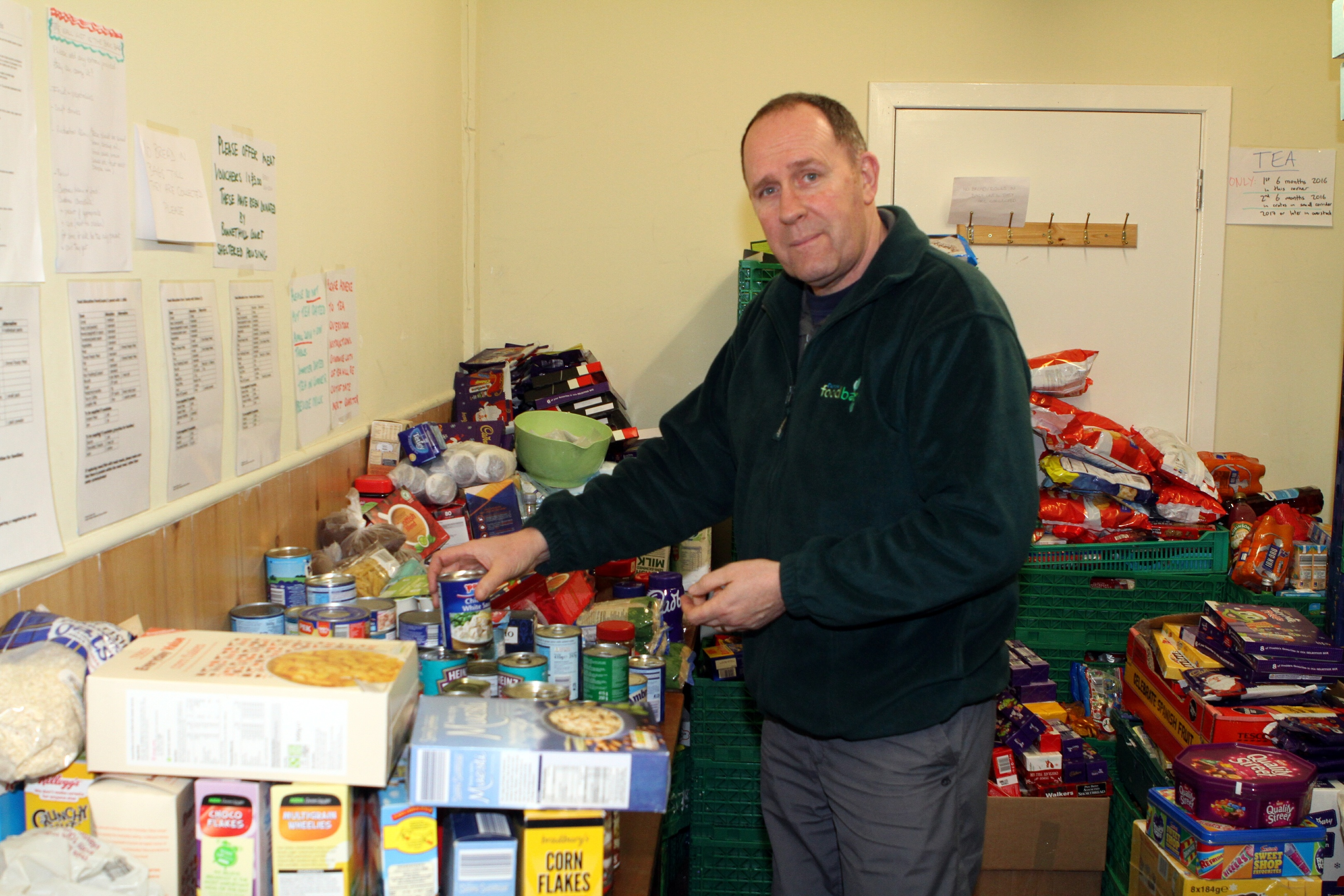 Ken Linton with some of the supplies at Dundee's  foodbank.