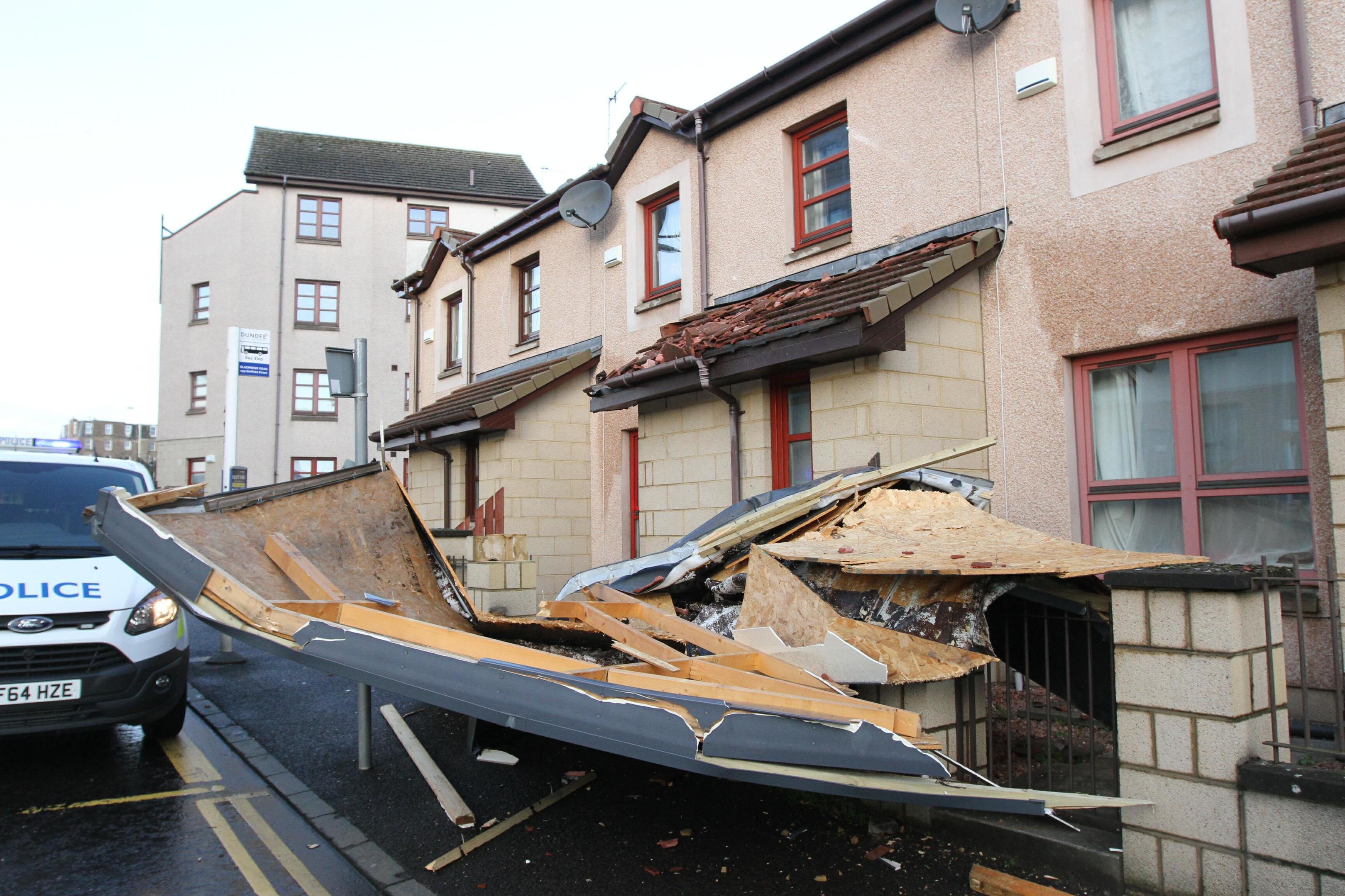 Police survey the damage at Blackness Road