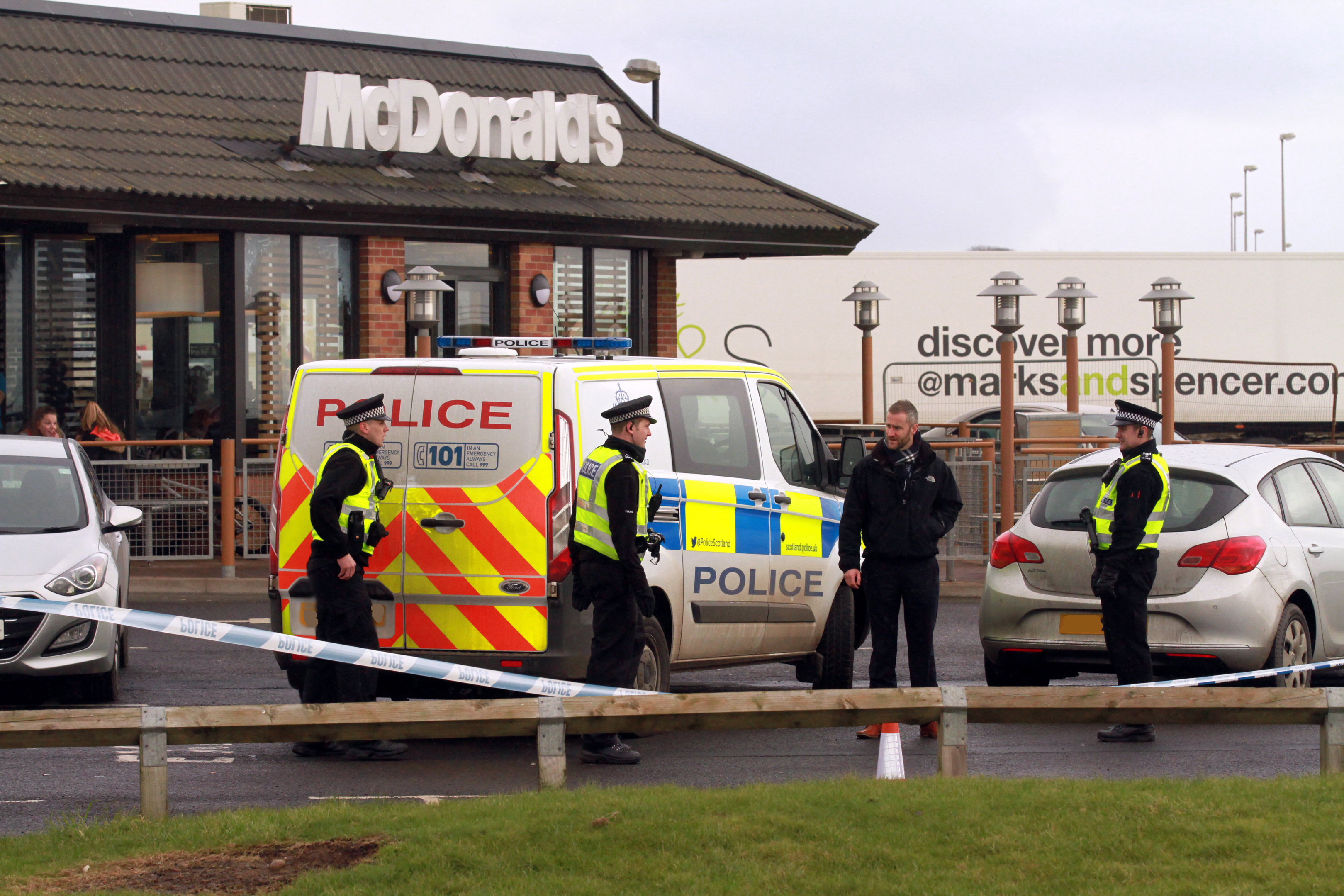 Police at McDonald's in Arbroath, where the gang were caught