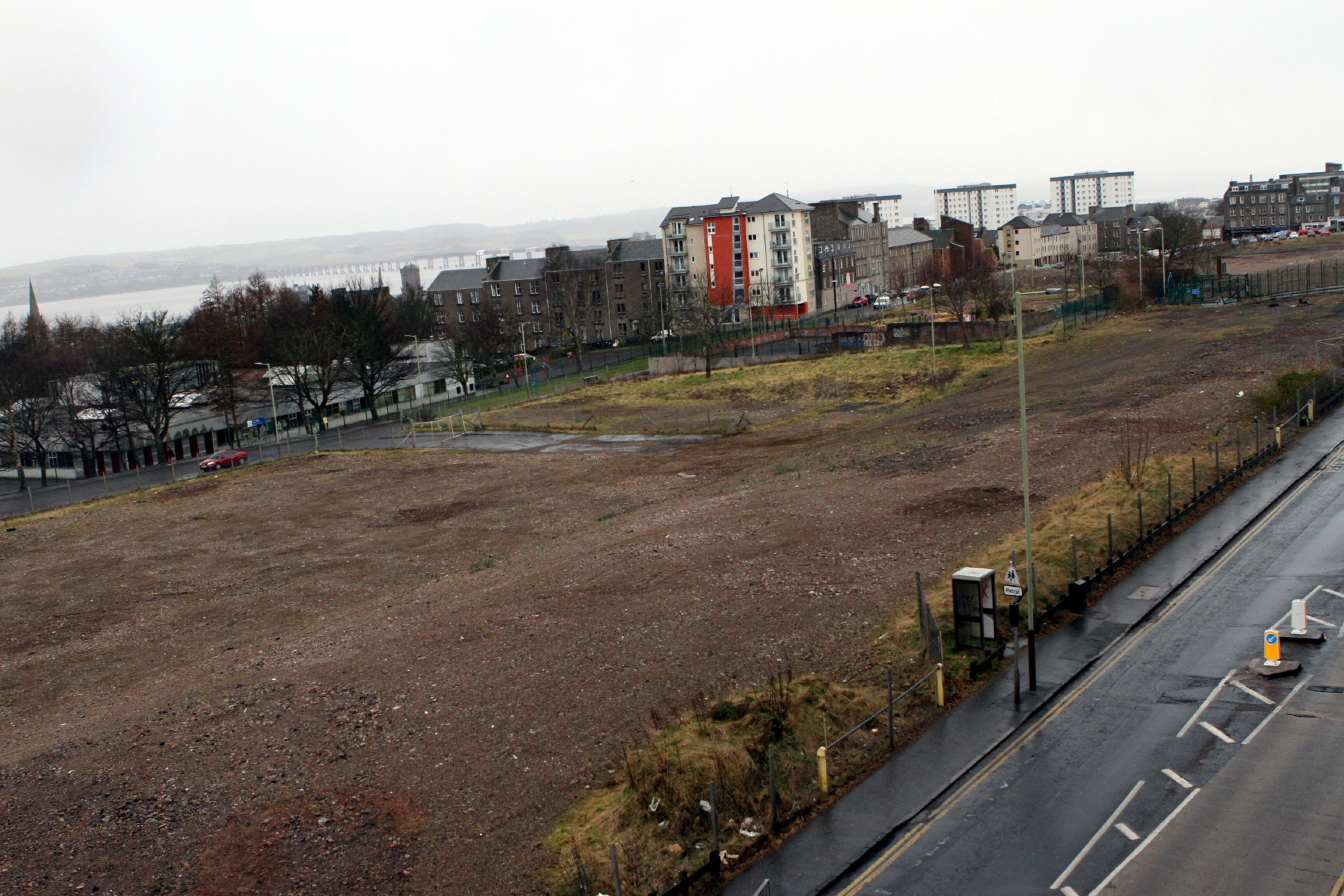 The Alexander Street site where the multis once stood. Inset: how the new housing development will look.