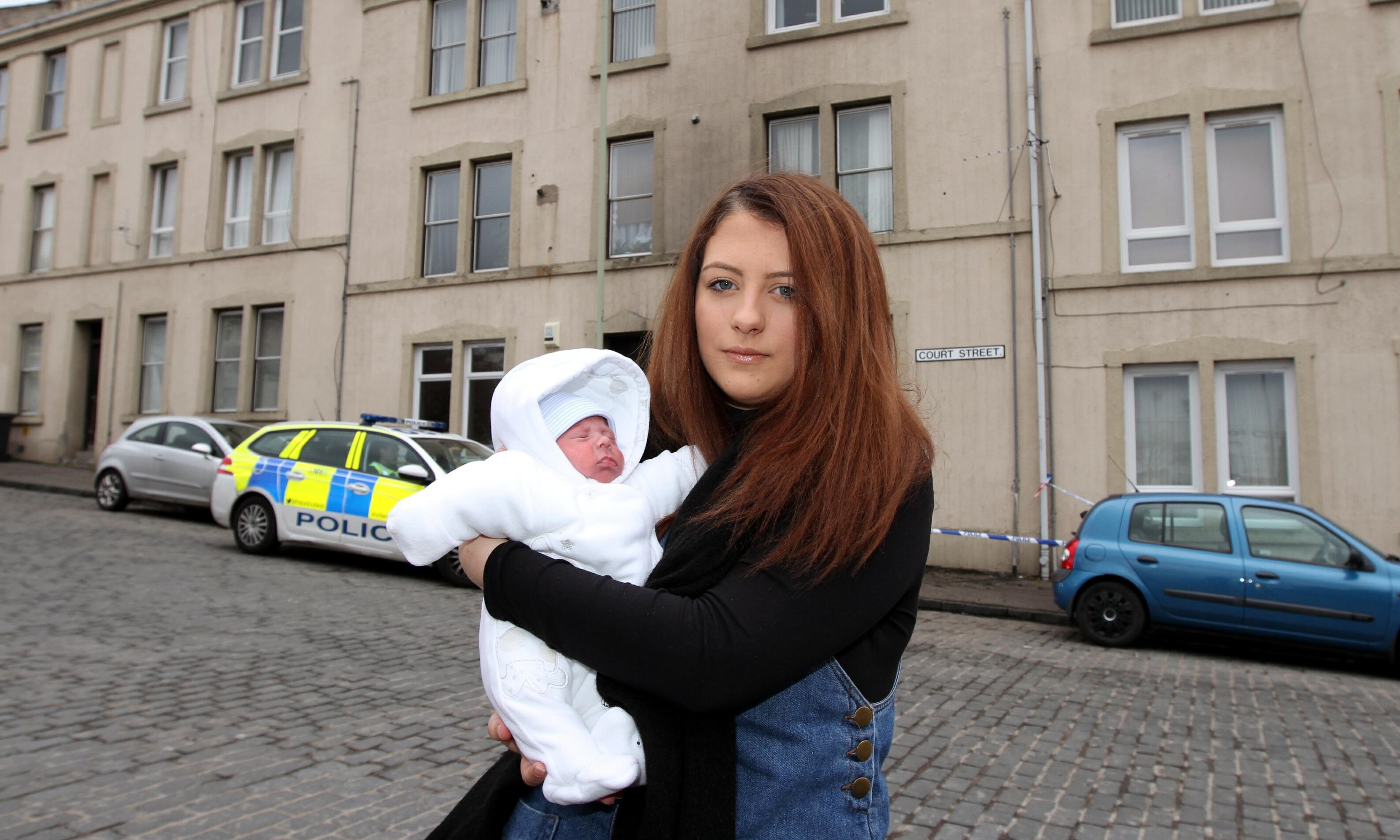 Megan with her son Arthur outside the tenement on Court Street