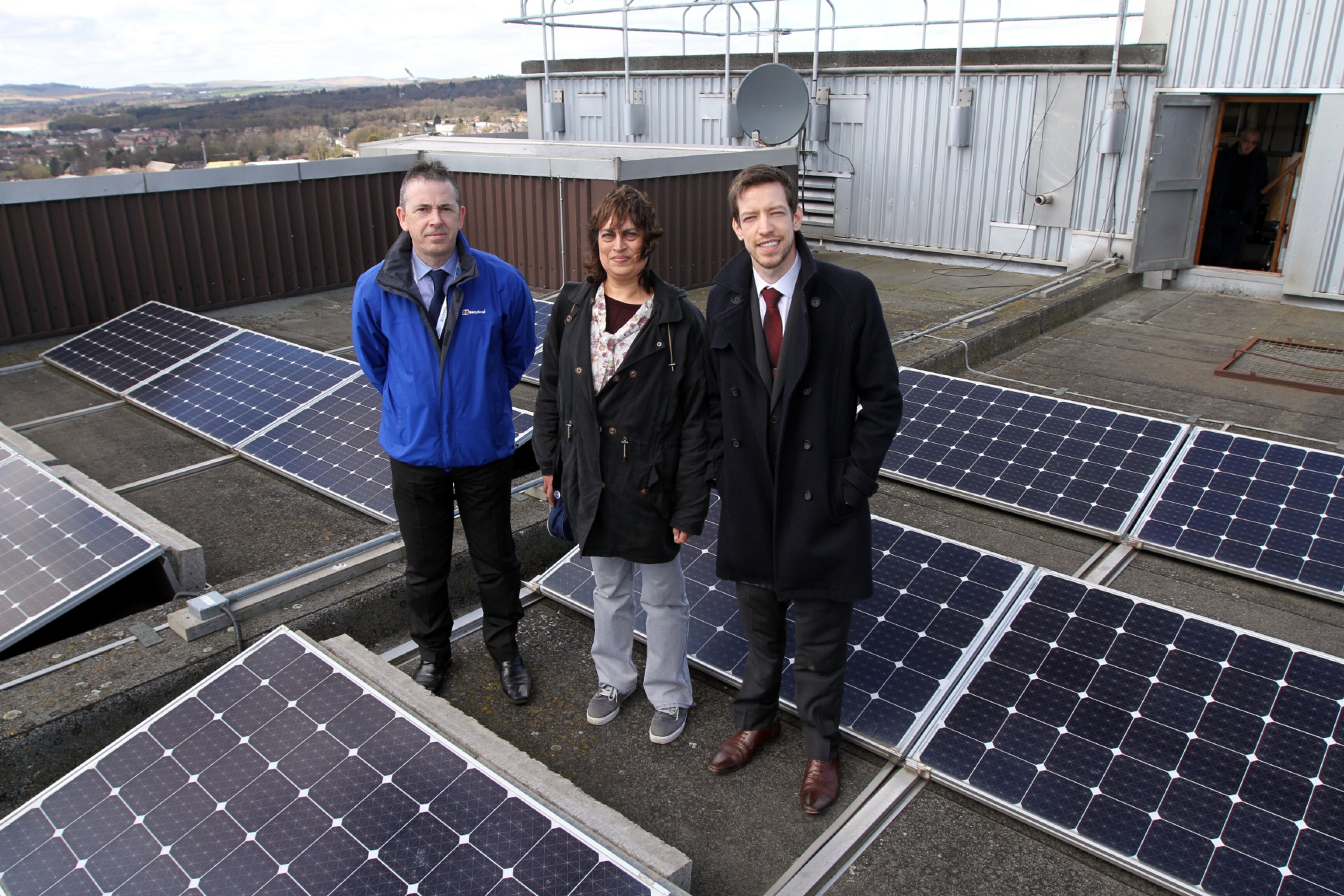 Councillor John Alexander, right, with Jenny Kermally of Friends of the Earth, and Douglas Fraser, estate services coordinator