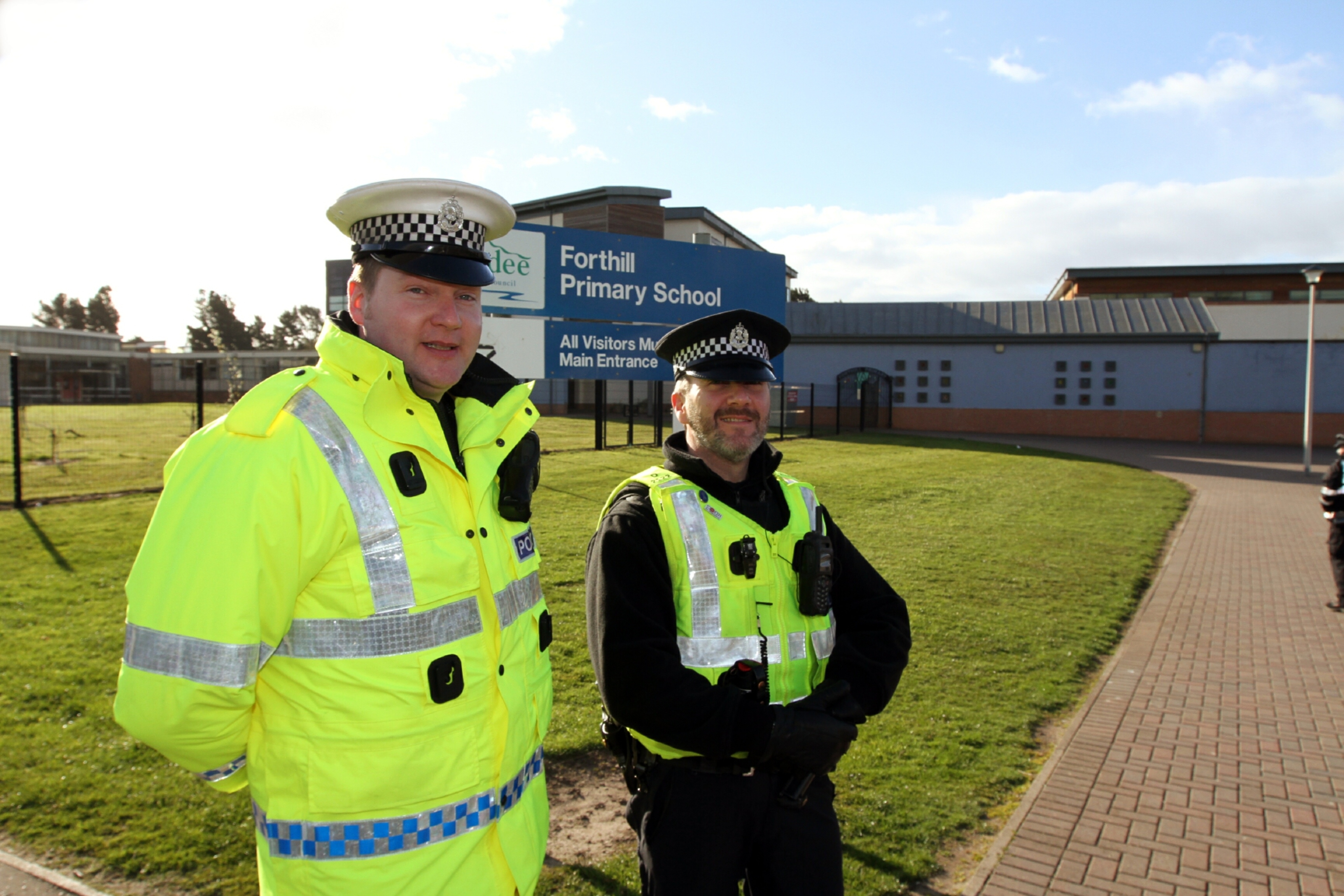 PC Gordon Dickson, of the road policing unit, with PC Darren Banister outside Forthill Primary School in Broughty Ferry.