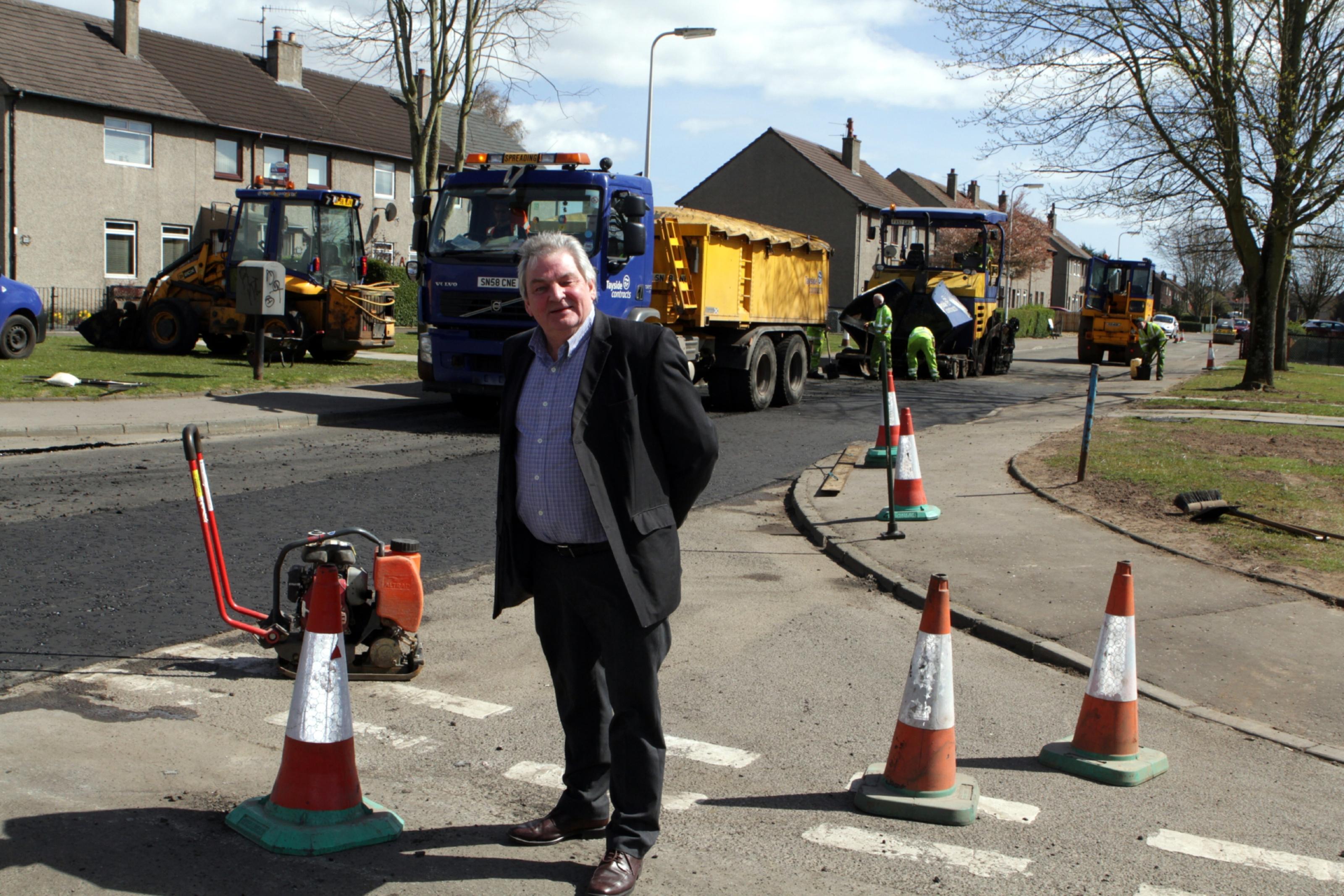 Councillor Brian Gordon at Finella Gardens, where road repairs have begun.