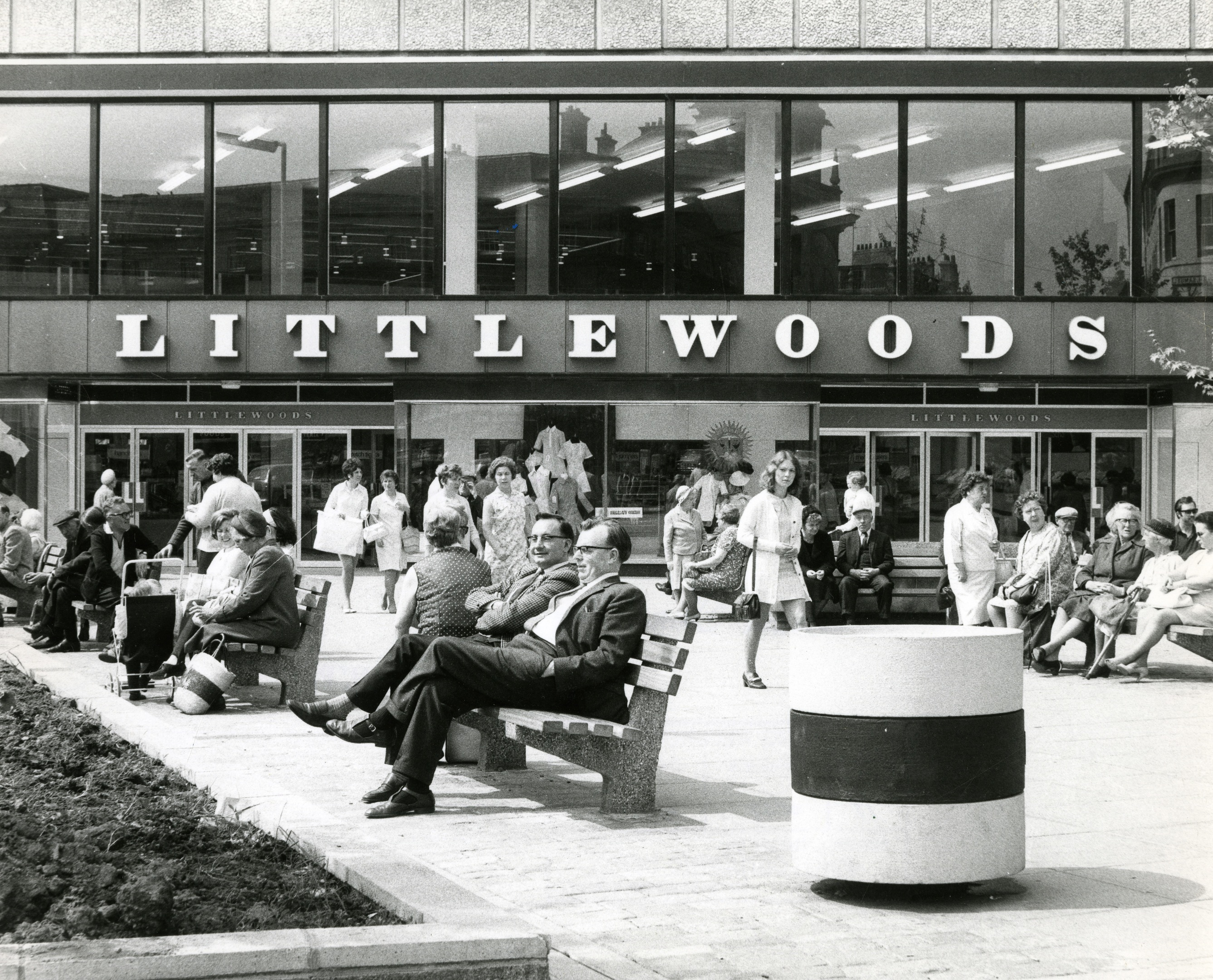 Folk sit outside the old Littlewoods store (now Primark) in 1970