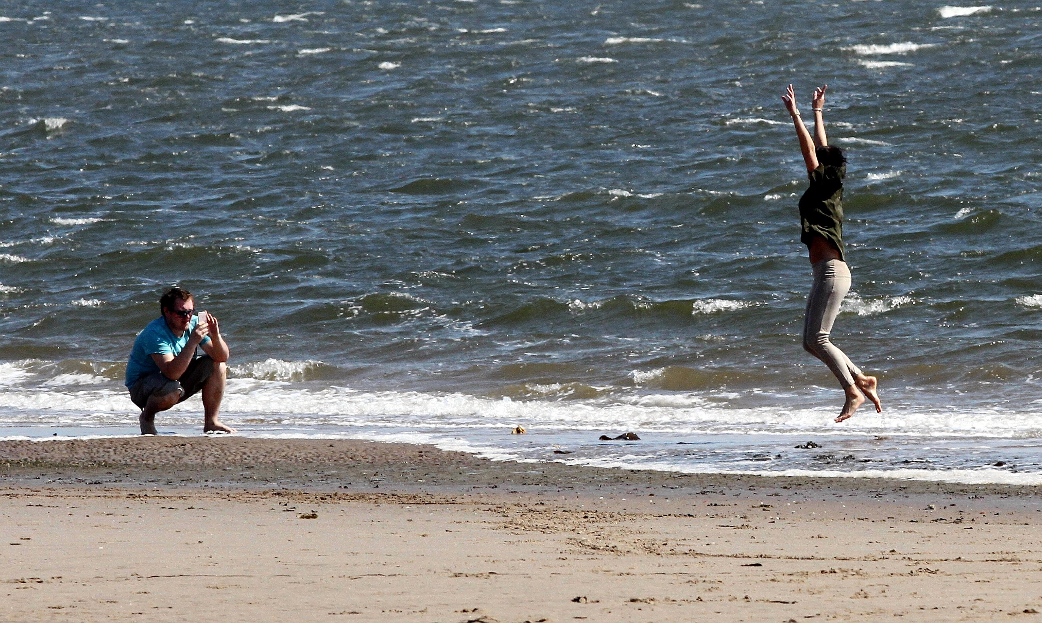 One couple have fun in the sun at Broughty beach earlier in the week.